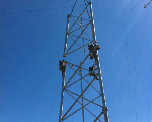Tower crew installing a section of the tower on Smith Peak